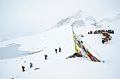 Monks, people and pack animals at snow-covered pass, Shingo La, Zanskar Range Traverse, Zanskar Range, Zanskar, Ladakh, India