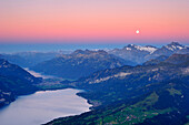 View from mount Niesen over Lake Thun to Wetterhorn with full moon, UNESCO World Heritage Site Jungfrau-Aletsch protected area, Bernese Oberland, canton of Bern, Switzerland