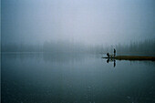 Two People at Edge of Misty Lake