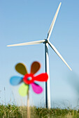 Toy windmill and large wind turbine, Black Forest, Baden-Wurttemberg, Germany