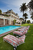Garden terrace at the swimming pool of the Hotel Ellerman House, Bantry Bay, Cape Town, Western Cape, South Africa