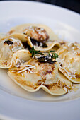 Homemade ravioli of slow baked lamb shoulder with sage butter and parmesan cheese, Restaurant Carne SA, Cape Town, Western Cape, South Africa