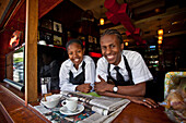 Two waiters at a coffee shop on Long Street, Cape Town, Western Cape, South Africa