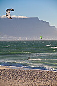 Beach impression with kitesurfers at Bloubergstrand with views of Table Mountain and Cape Town, Western Cape, South Africa, RSA, Africa