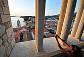 Woman taking a photograph, view from the tower of St. Andriji over the town of Rab, Rab Island, Kvarnen Gulf, Croatia