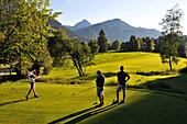 Teenagers playing golf, Golf club Goldegg in Pongau, Salzburg-land, Austria