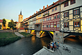 Kraemerbruecke, Bridge with half timbered buildings on both sides in the evenng light, Erfurt, Thuringia, Germany