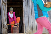 Young women cutting firewood, See, Tyrol, Austria