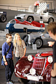 Students in the Transport Museum looking at an oldtimer, Deutsches Museum, German Museum, Munich, Bavaria, Germany