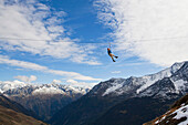 A girl flying across a rope over a valley, Sewenhut, Kanton Uri, Switzerland