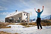 A woman balancing on a slackline at the Sewenhut, SAC, Swiss Alpine-Club, Swiss Alps, Kanton Uri, Switzerland