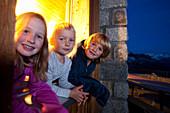 Two girls and a boy in a mountain hut, the Sewenhut, SAC Swiss Alpine-Club, Swiss Alps, Kanton Uri, Switzerland