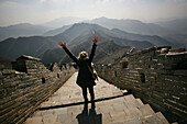 Tourist cheering on Great Wall of China, China