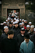The Hui community, Chinese Muslims, arrive at a mosque for Friday Prayers, Xian Great Mosque, Xian, Xi'an, Capital of Shaanxi Province, China