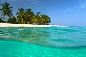 Looking ashore to Cayo Levantado as viewed half underwater, Cayo Levantado off Samana, Dominican Republic