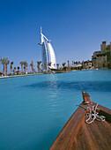 Boat heading towards Mina A'Salam and Burj Al Arab hotels, Mina A'Salam and Burj Al Arab hotels, Minat Jumeirah, Dubai
