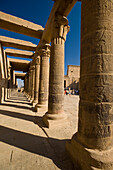 Looking along West Colonnade to Temple of Isis, Philae Island, near Aswan, Egypt