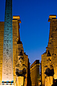 Large obelisk and colossi statues of Pharaohs, Luxor Temple, Luxor, Egypt