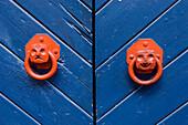 Smiling and unhappy door handle faces, Close Up, Tallinn. Estonia