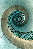 Looking up the spiral staircase of the lighthouse, Ile Vierge near Aber Wrach, Brittany, France