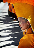Nuns in traditional dress with yellow orange hats and robes at 800 year old birthday celebration / rituals of the Buddhist Drukpa Lineage, Naro Photang Shey, ( Shey Monastery ), Leh Ladakh, Indian Himalayas, India, Nuns in traditional dress with yellow or