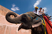Mahout and tourist on elephant, Amber Fort near Jaipur, Rajasthan, India
