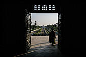 Elderly woman exiting Ujjayanta Palace, Agartala, Tripura, North East States, India