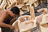 Man carving wooden hand chairs, Bali, Indonesia