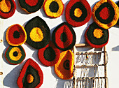 Colorful Rasta hats for sale beside the road, Orocabessa, Jamaica
