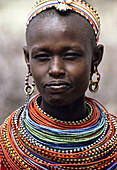 Women adorned with beads, Nairobi