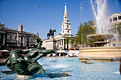 Low angle view of Trafalgar Square in London with fountains and statues, London, UK