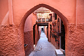 Looking down a colorful narrow alleyway / lane in the souk Marrakesh, Morocco, Marrakesh, Morocco