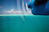 Airplane's  propeller over Soneva Fushi lagoon, Northern Atoll, Maldives