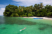 Snorkeling in Lagoon of Ahe Island, Cenderawasih Bay, West Papua, Indonesia