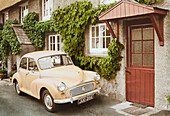 Vintage car in front of a house, Devon, Southern England, Great Britain, Europe