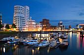 Modern buildings at Neuer Zollhof at night, Media harbour, Duesseldorf, North Rhine-Westphalia, Germany, Europe