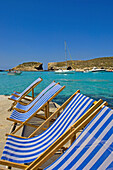 Empty deckchairs at Blue Lagoon, Comino Island, Malta