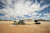 Airplane and truck on an airstrip in Kaokoland Desert, Kaokoland Desert, North West Namibia