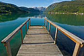 Wooden jetty going onto fjord, Hardanger Fjord. Ulvik. Norway