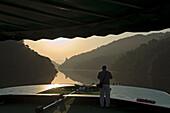 Old man enjoying sunrise on Douro Valley River Cruise, Portugal