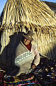 Handicraft seller, Uros Islands, Lake Titicaca, Peru
