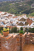 View from patio of whitewashed village nestled in mountains, Frigiliana, Costa del Sol, Spain