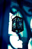 Moorish lantern hanging in courtyard, Seville, Spain