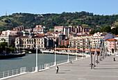 People along banks of River Nervion, Bilbao, Basque Region, Spain