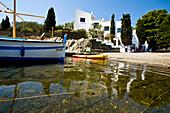 Boat moored on shore of Port Lligat, Costa Brava, Catalonia, Spain