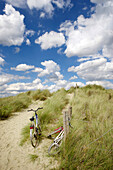 Bikes against a fence in the dunes, West Sussex, England