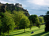 Couple in park, Edinburgh Castle, Scotland, UK