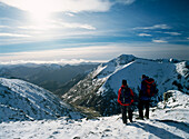 Couple on top of Aonach Mor with Ben Nevis behind, Inverness-shire, Scotland