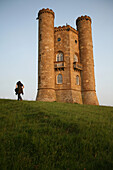 Tourist at Broadway Tower, second highest point in the Cotswolds, Worcestershire, England, UK