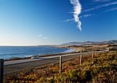 Car traveling on Route 1 along the Big Sur coastline, Near San Simeon, California